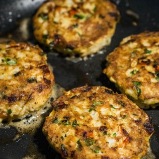 Low Carb Crab Cakes Cooking in a non stick pan