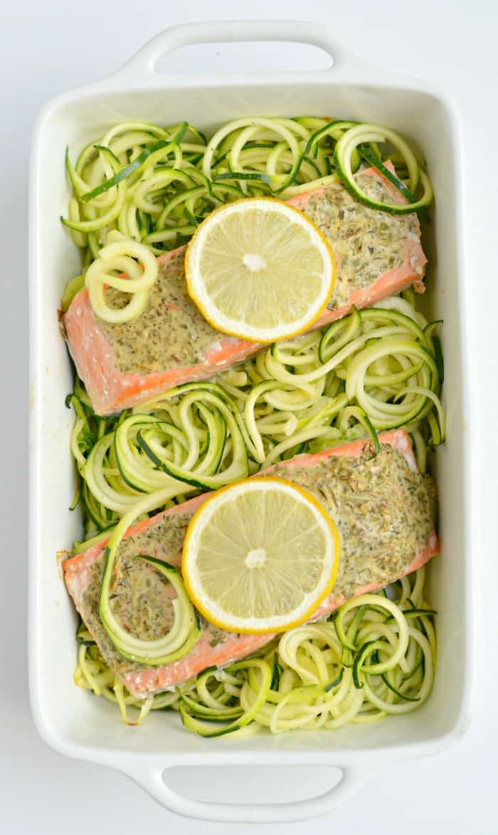 Lemon and Herb Salmon on spiralized zucchini in a white casserole dish