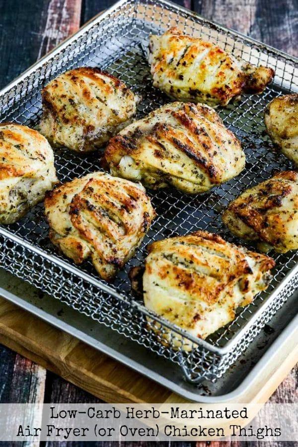 herb marinated air fryer chicken thighs in an air fryer basket
