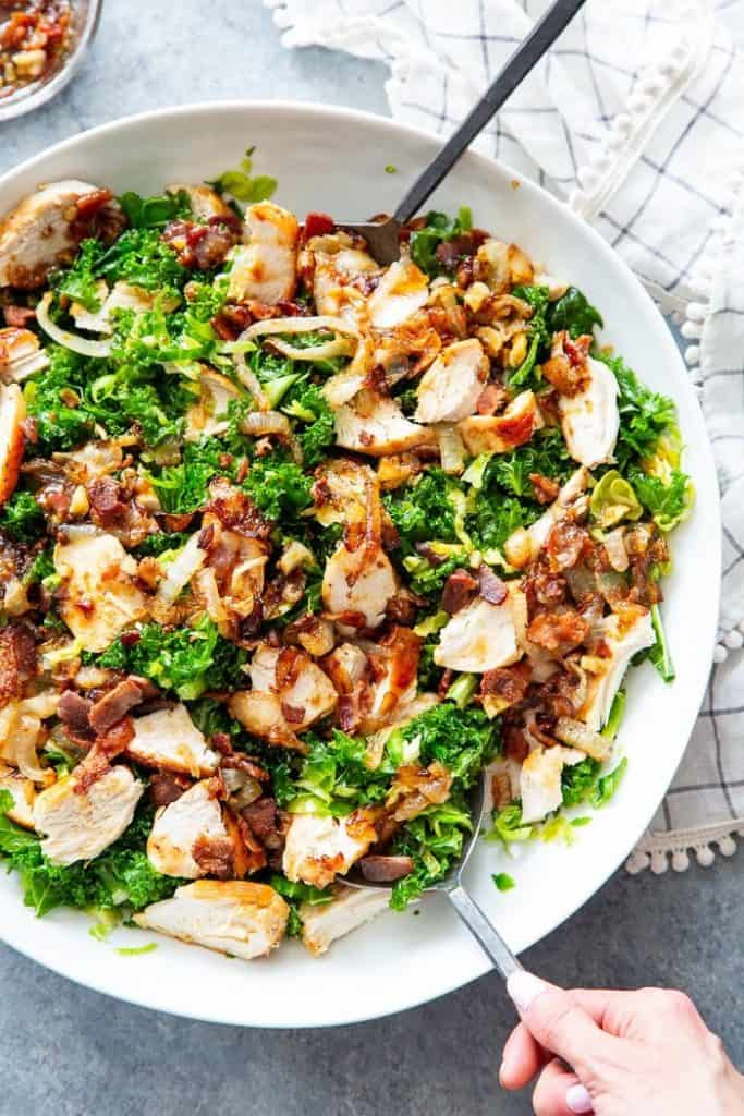 kale salad with chicken caramelized onions and hot bacon dressing