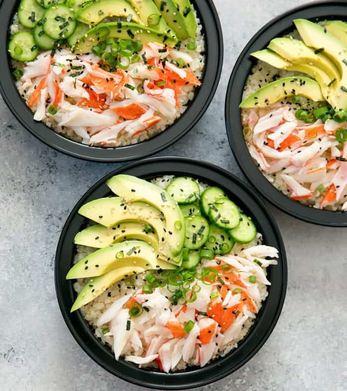 keto crab sushi bowl in a black bowl on a grey background