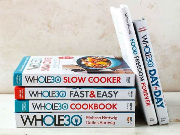 A stack of whole 30 books