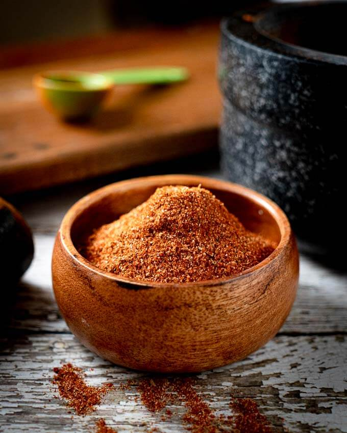 taco seasoning mix in a small wooden bowl