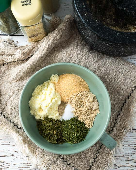 ingredients for homemade ranch seasoning in a green bowl